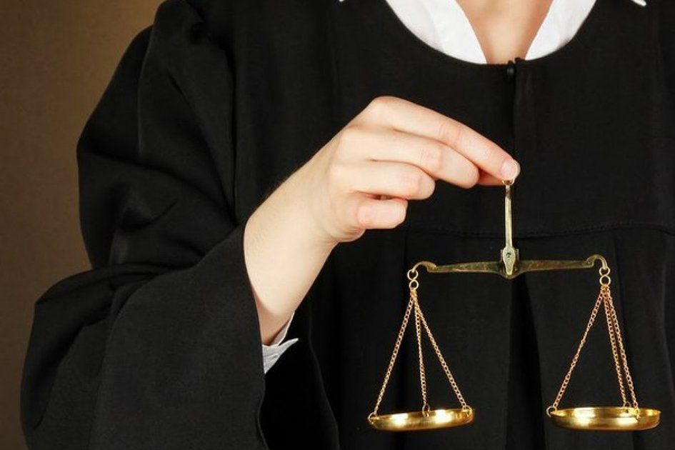 justice-scales-in-judge-hand.jpg
