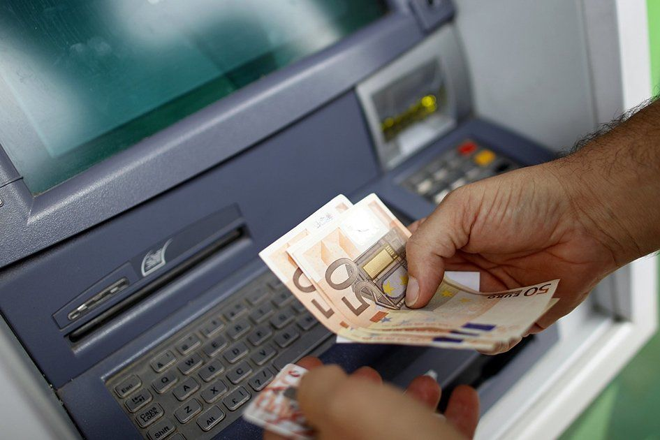 cash-withdrawal-at-an-atm.jpg